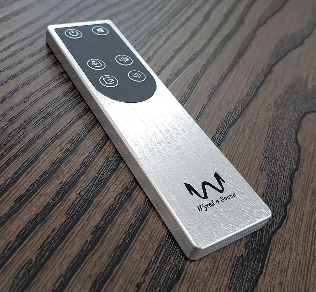 mINT/mPRE Aluminum remote control on wood